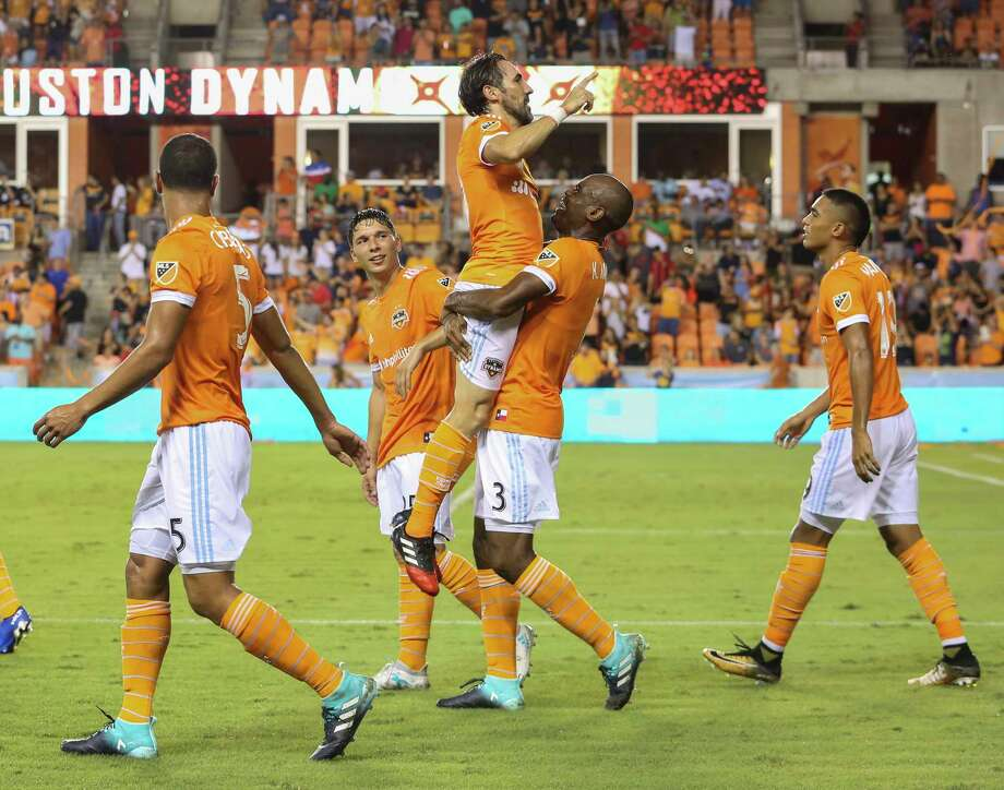 Dynamo defender Adolfo Machado carries forward Vicente Sanchez to celebrate Sanchez's second-half goal in a 3-0 win over the Earthquakes on Saturday. Photo: Yi-Chin Lee, Staff / © 2017  Houston Chronicle