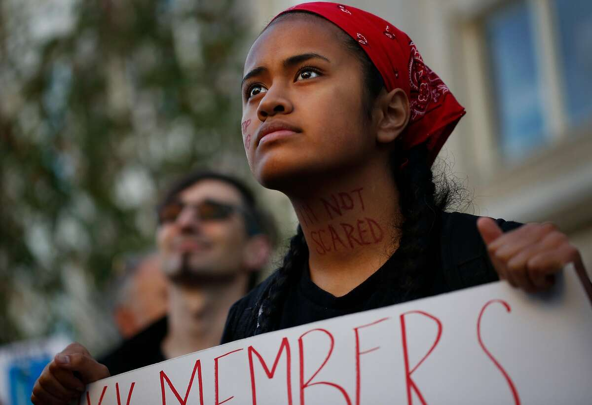 Lucy Siale listens to speakers during a Bay Area United Against White Supremacy rally in solidarity with Charlottesville August 12, 2017 in Oakland, Calif.