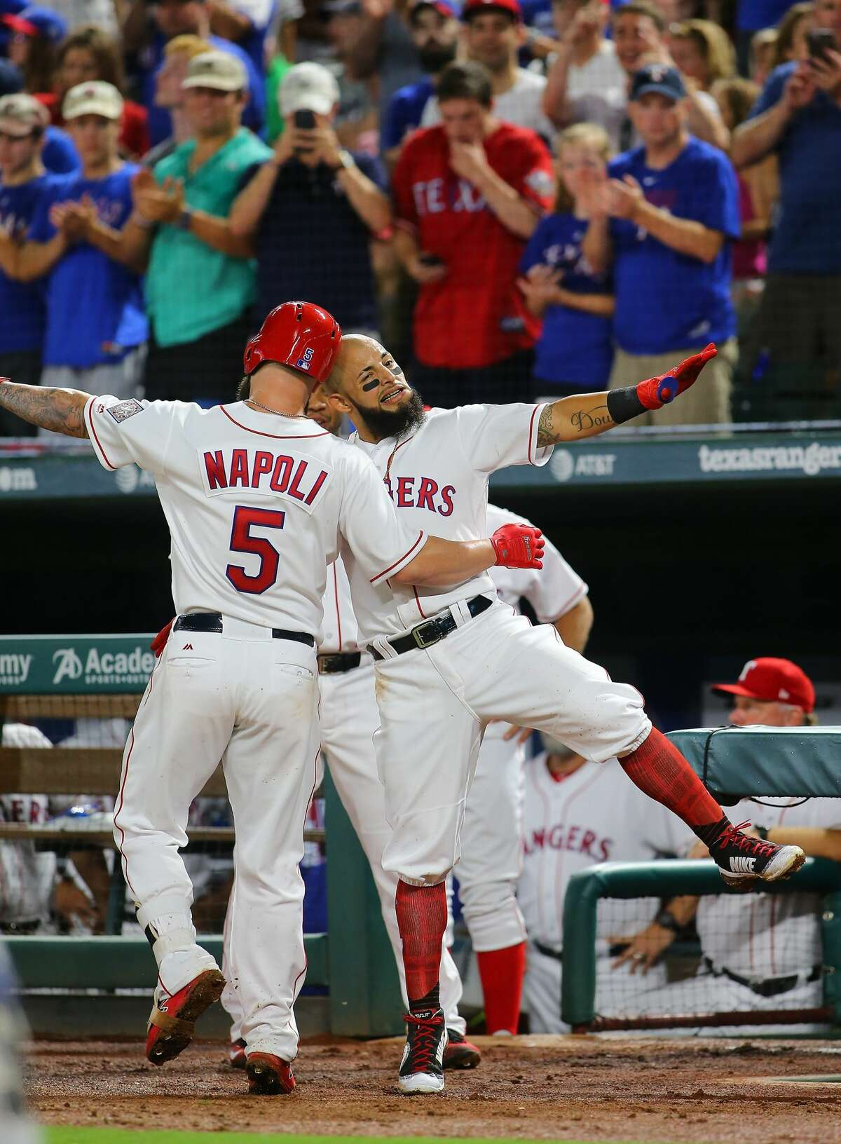 ARLINGTON, TX - AUGUST 12: Rougned Odor #12 of the Texas Rangers and Mike Napoli #5 celebrate Napoli hitting a solo home run in the fourth inning against the Houston Astros at Globe Life Park in Arlington on August 12, 2017 in Arlington, Texas. (Photo by Rick Yeatts/Getty Images)