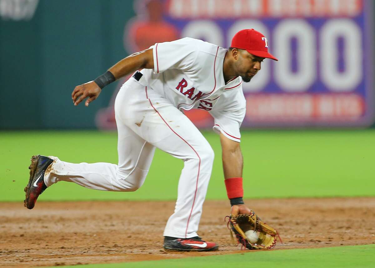 ARLINGTON, TX - AUGUST 12: Elvis Andrus #1 of the Texas Rangers fields a ground ball in the fourth inning against the Houston Astros at Globe Life Park in Arlington on August 12, 2017 in Arlington, Texas. (Photo by Rick Yeatts/Getty Images)