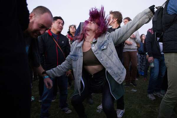 Ashlee Mcrae dances to Metallica during day two of the Outside Lands music festival at Golden Gate Park on Saturday, Aug. 12, 2017, in San Francisco, Calif.