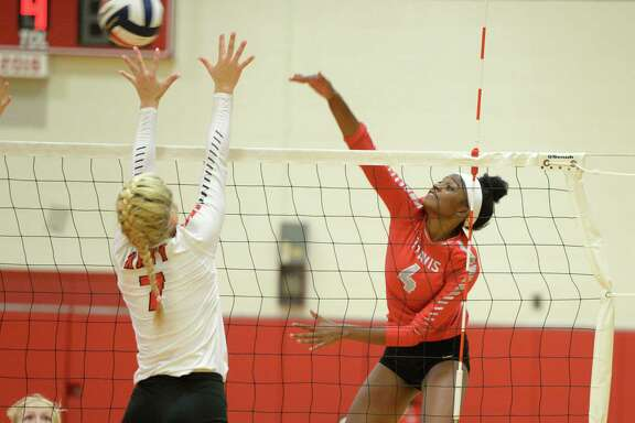 Lauren Clarke (4) of Travis hits a kill shot past Autumn Gentry (7) of Katy in the second set of a high school volleyball game between the Katy Tigers and the Travis Tigers during the 2017 Cy-Fair ISD/Katy ISD Classic on August 10, 2017 at Katy High School, Katy, TX.