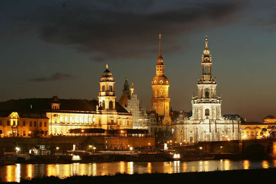 DRESDEN, GERMANY - SEPTEMBER 21: Buildings of Dresden's Old Town stand illuminated on the banks of the Elbe River September 21, 2005 in Dresden, Germany. Photo: Sean Gallup/Getty Images
