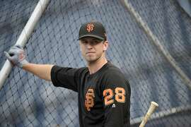 San Francisco Giants' Buster Posey looks on during batting practice before a baseball game against the Washington Nationals, Saturday, Aug. 12, 2017, in Washington. (AP Photo/Nick Wass)