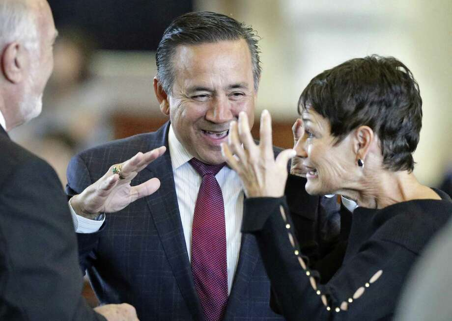 Sen. Carlos Uresti, D-San Antonio, shares a laugh with Sen. Donna Campbell, R-New Braunfels, as legislators convene the Saturday session. Photo: Tom Reel / San Antonio Express-News / 2017 SAN ANTONIO EXPRESS-NEWS