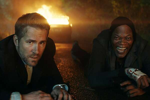 "This image released by Lionsgate shows Samuel L. Jackson, right, and Ryan Reynolds in ""The Hitman's Bodyguard."" (Lionsgate via AP)"