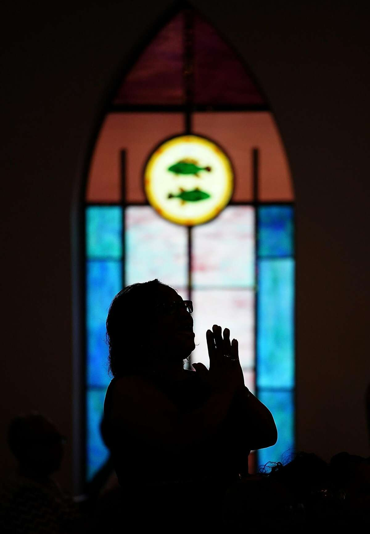 CHARLOTTESVILLE, VA - AUGUST 13: Worshipers sing while attending morning services at Mount Zion First African Baptist Church August 13, 2017 in Charlottesville, Virginia. The city of Charlottesville is still reeling following violence at a 'Unite the Right' rally held by white nationalists, neo-Nazis and members of the 'alt-right'. (Photo by Win McNamee/Getty Images)