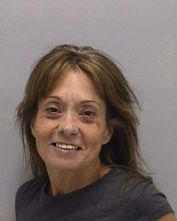 Jennifer L. Decrescenzo, 48, of Milford, was arrested after police reportedly found her incapacitated at the wheel of a running vehicle earlier this month. Photo courtesy of the Orange Police Department. Photo: Contributed / Contributed