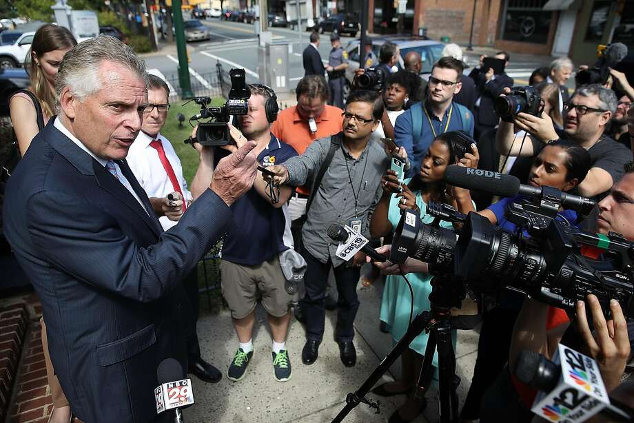 Virginia Gov. Terry McAuliffe tells reporters that police acted responsibly under intense circumstances during the violent white nationalist rally in Charlottesville on Saturday night. Photo: Win McNamee, Getty Images