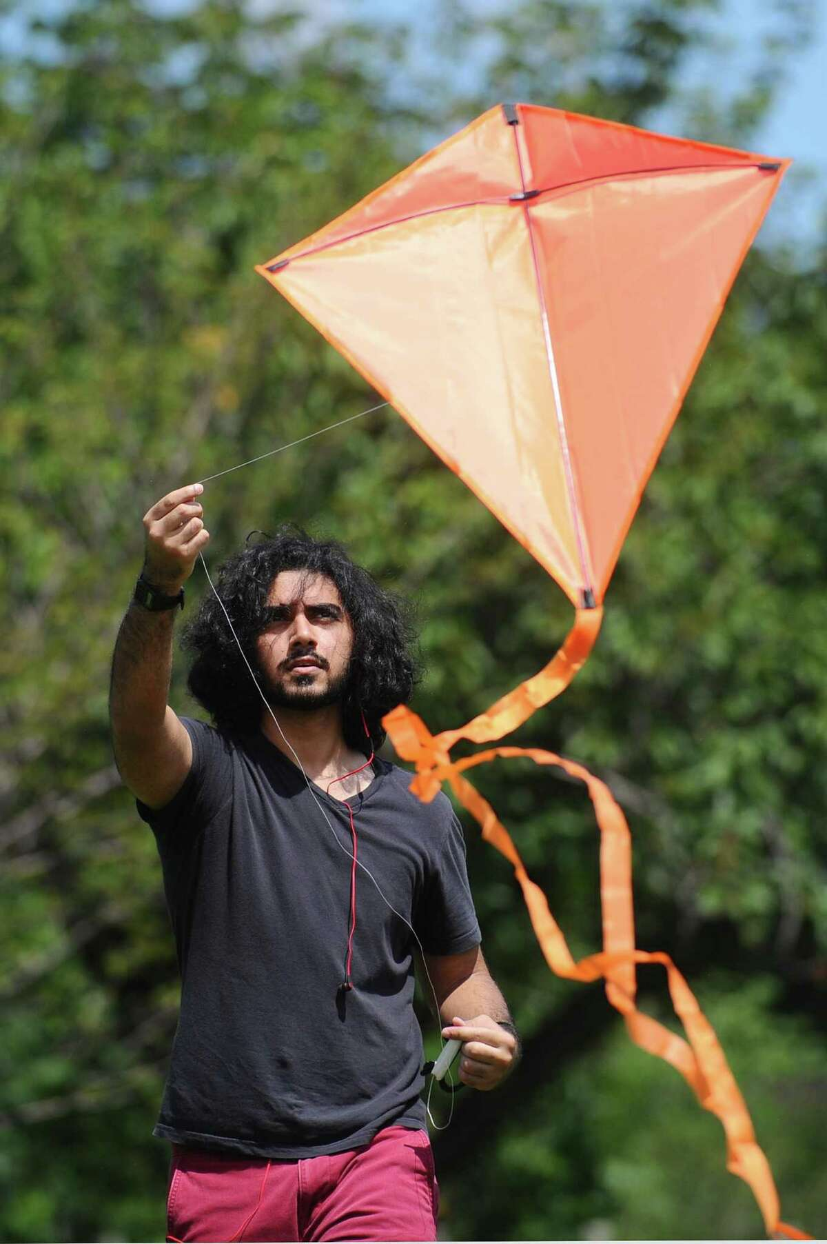 19-year-old Mohammad Faisal Vasanwala, of Stamford, flies a kite during the India Day Festival at Mill River Park in Stamford, Conn. on Sunday, August 13, 2017.
