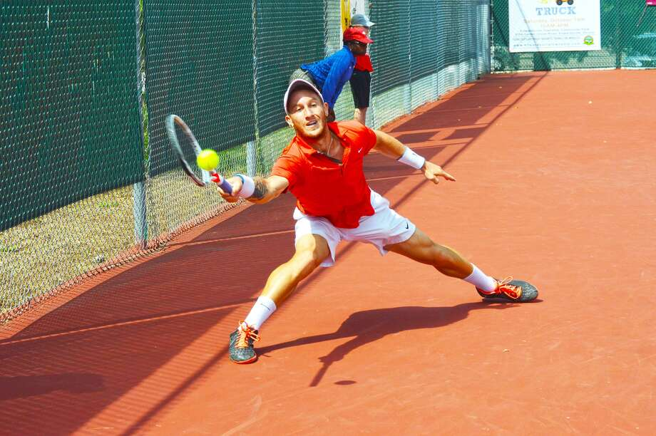 Or Ram-Harel reaches to make a forehand return on Sunday during the singles championship of the USTA Edwardsville Futures at the Edwardsville High School Tennis Center.