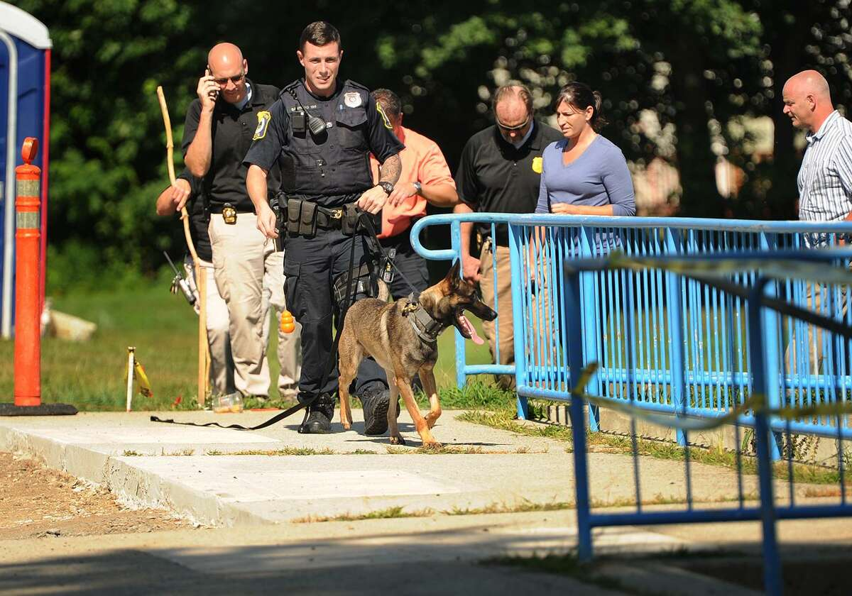 Stratford Police search a large field next to Nichols School at the intersection of Nichols Avenue and North Avenue in Stratford, Conn. on Sunday, August 13, 2017. A fatal shooting took place nearby outside 1584 North Avenue on Saturday night.