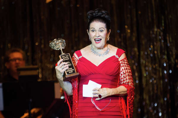 Tina Cafeo reacts after being presented the Lifetime Achievement Award during The Montie Awards on Saturday, Aug. 12, 2017, at the Crighton Theatre.