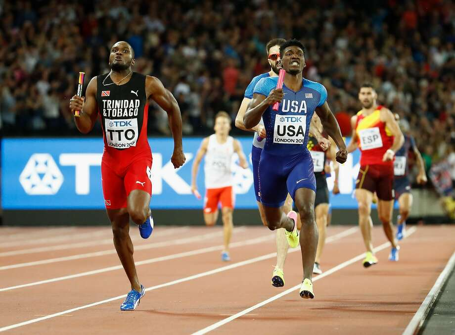 Lalonde Gordon of Trinidad and Tobago races to the finish line ahead of Fred Kerley of the United States and Martyn Rooney of Great Britain in the men's 4-by-400 meter relay final. Photo: Andy Lyons, Getty Images For IAAF