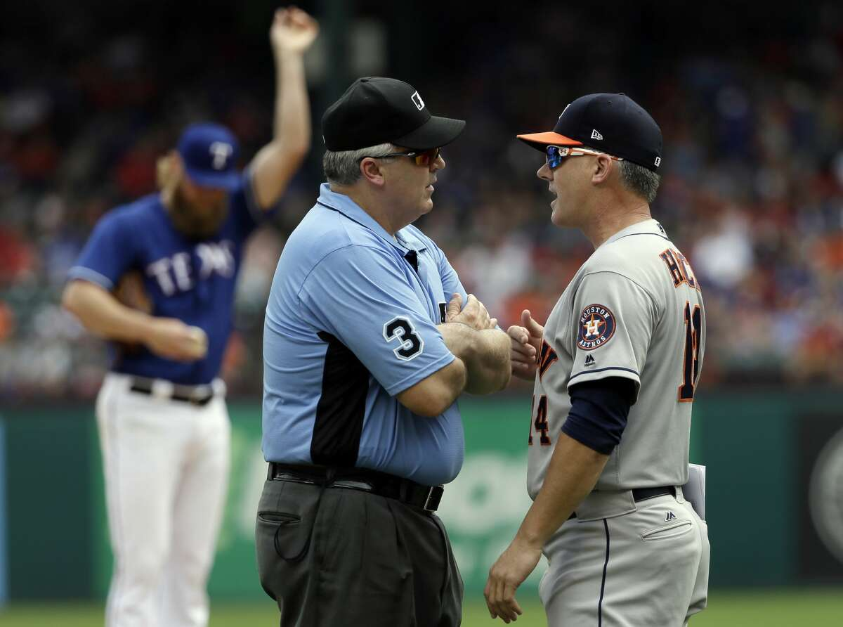 PHOTOS: All the photos from Astros-Rangers games this season Crew chief Bill Welke (3) listens as Houston Astros manager A.J. Hinch argues after a warning to both benches in the fifth inning of a baseball game against the Texas Rangers, Sunday, Aug. 13, 2017, in Arlington, Texas. Both benches were warned after Rangers starter Andrew Cashner, rear, hit the Astros' Marwin Gonzalez wth a pitch in the fifth inning. (AP Photo/Tony Gutierrez)