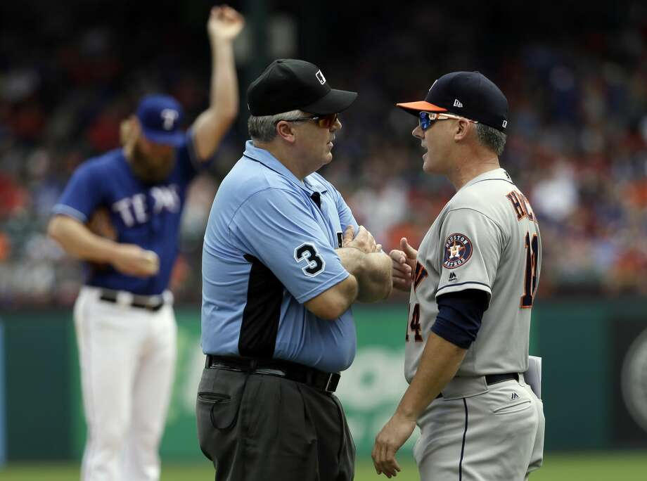 PHOTOS: All the photos from Astros-Rangers games this seasonCrew chief Bill Welke (3) listens as Houston Astros manager A.J. Hinch argues after a warning to both benches in the fifth inning of a baseball game against the Texas Rangers, Sunday, Aug. 13, 2017, in Arlington, Texas. Both benches were warned after Rangers starter Andrew Cashner, rear, hit the Astros' Marwin Gonzalez wth a pitch in the fifth inning. (AP Photo/Tony Gutierrez) Photo: Tony Gutierrez/Associated Press