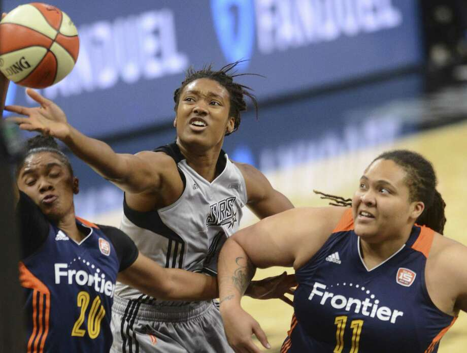 Kayla Alexander of the Stars shoots a layup as Alex Bentley (20) and Danielle Adams (11) of the Connecticut Sun defend during second-half action at the AT&T Center on July 5, 2017. Photo: Billy Calzada /San Antonio Express-News / San Antonio Express-News