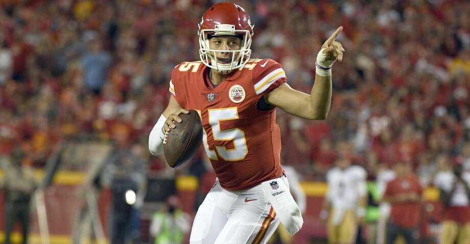 Kansas City Chiefs quarterback Patrick Mahomes (15) signals before throwing to Marcus Kemp for a touchdown against the San Francisco 49ers during the second half of an NFL preseason football game in Kansas City, Mo., Friday, Aug. 11, 2017. (AP Photo/Ed Zurga) Photo: Ed Zurga/Associated Press