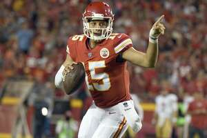 Kansas City Chiefs quarterback Patrick Mahomes (15) signals before throwing to Marcus Kemp for a touchdown against the San Francisco 49ers during the second half of an NFL preseason football game in Kansas City, Mo., Friday, Aug. 11, 2017. (AP Photo/Ed Zurga)