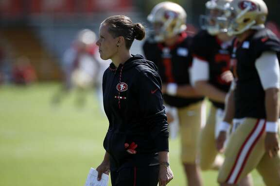 Katie Sowers, a coaching intern for the San Francisco 49ers, keeps an eye on training camp in Santa Clara, Calif., on August 8, 2017. (Karl Mondon/Bay Area News Group/TNS)