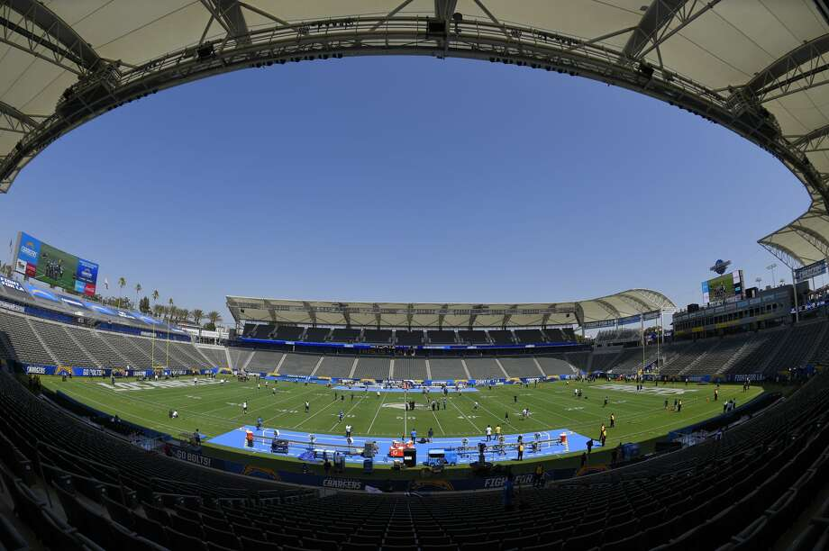 Players for the Seattle Seahawks and the Los Angeles Chargers walk on the field before a preseason NFL football game at the StubHub Center, Sunday, Aug. 13, 2017, in Carson, Calif. (AP Photo/Mark J. Terrill) Photo: Mark J. Terrill/AP