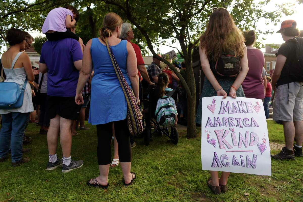 People gather in Townsend Park to rally against white supremacy on Sunday, Aug. 13, 2017, in Albany, N.Y. (Paul Buckowski / Times Union)