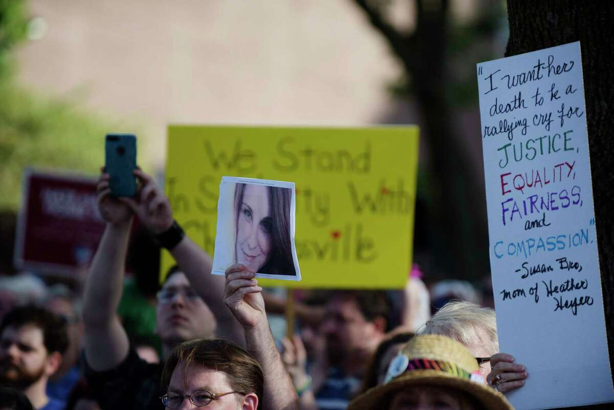 A photo of Heather Heyer, the woman killed in Charlottesville, is held up during a rally in Townsend Park against white supremacy on Sunday, Aug. 13, 2017, in Albany, N.Y. (Paul Buckowski / Times Union)