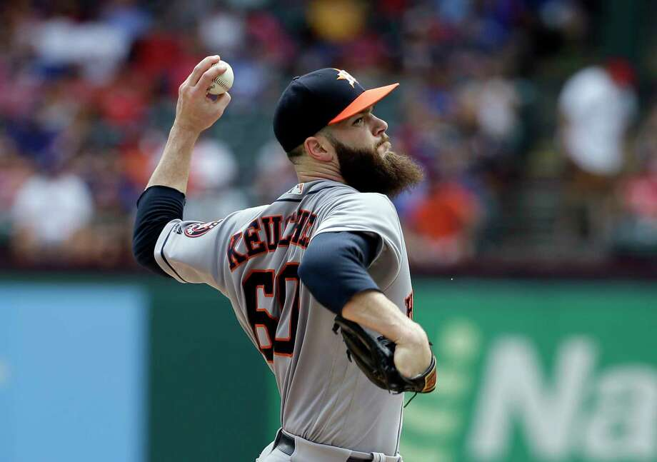 Houston Astros starting pitcher Dallas Keuchel throws to the Texas Rangers in the first inning of a baseball game, Sunday, Aug. 13, 2017, in Arlington, Texas. (AP Photo/Tony Gutierrez) Photo: Tony Gutierrez, STF / Copyright 2017 The Associated Press. All rights reserved.