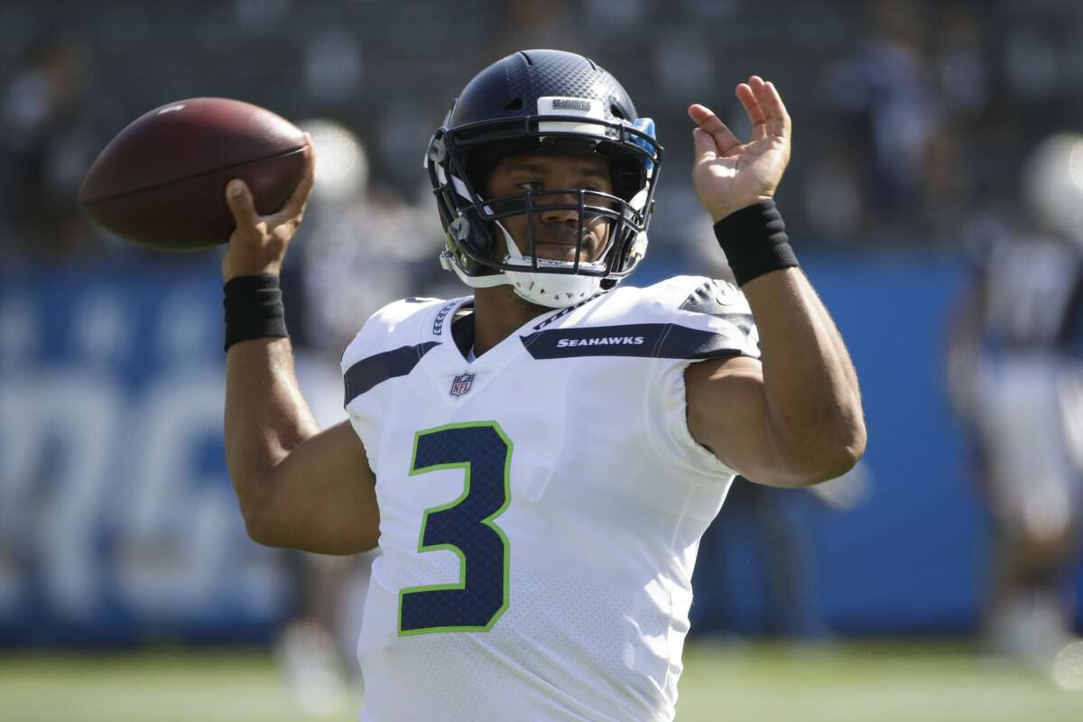 Seattle Seahawks quarterback Russell Wilson warms up before a preseason NFL football game against the Los Angeles Chargers Sunday, Aug. 13, 2017, in Carson, Calif. (AP Photo/Jae C. Hong)