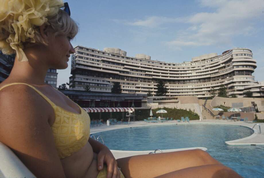 Close-up of lifeguard Linda Fox as she sits poolside at the Watergate complex, Washington DC, 1969. In the center rear is the Watergate East co-op apartment building. (Photo by Michael Rougier/The LIFE Picture Collection/Getty Images) Photo: Michael Rougier/The LIFE Picture Collection/Getty Images