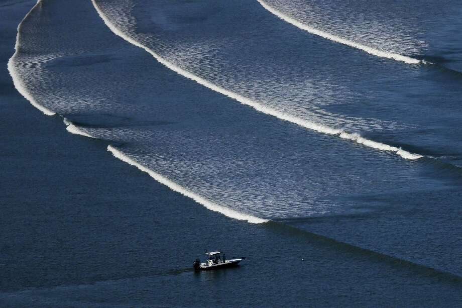 "Shown is an aerial view of a boat on the bay side of Bolivar Peninsula. Two groups graded the overall health of the Galveston Bay watershed — including not only the bay, but the multitude of bayous, creeks and rivers that drain into it — as a ""C,"" or ""adequate for now."" Photo: Michael Ciaglo /Houston Chronicle / © 2016  Houston Chronicle"