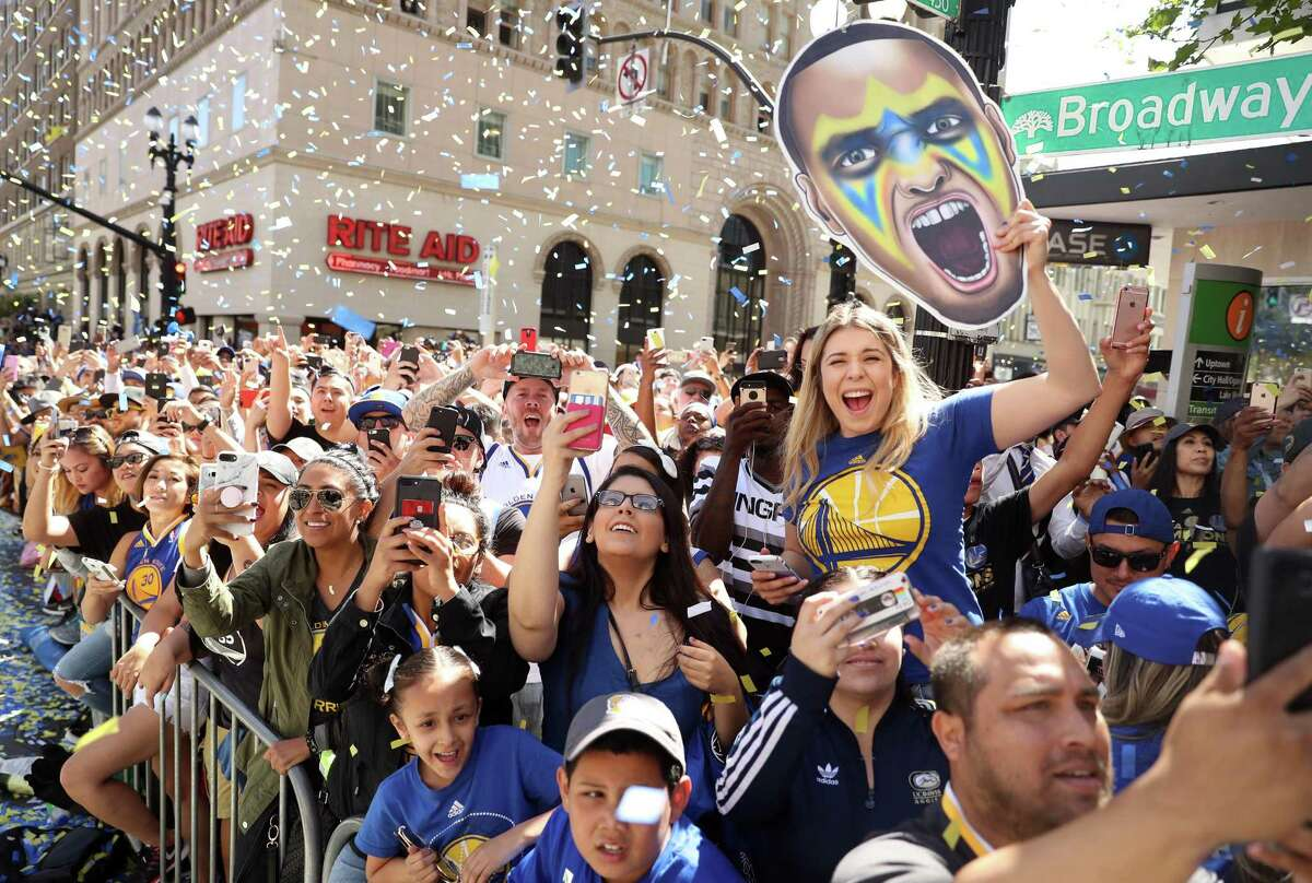 Fans cheer the Golden State Warriors during their victory parade in June. BART ordered extra preloaded Clipper cards for the parade, but few of them sold.
