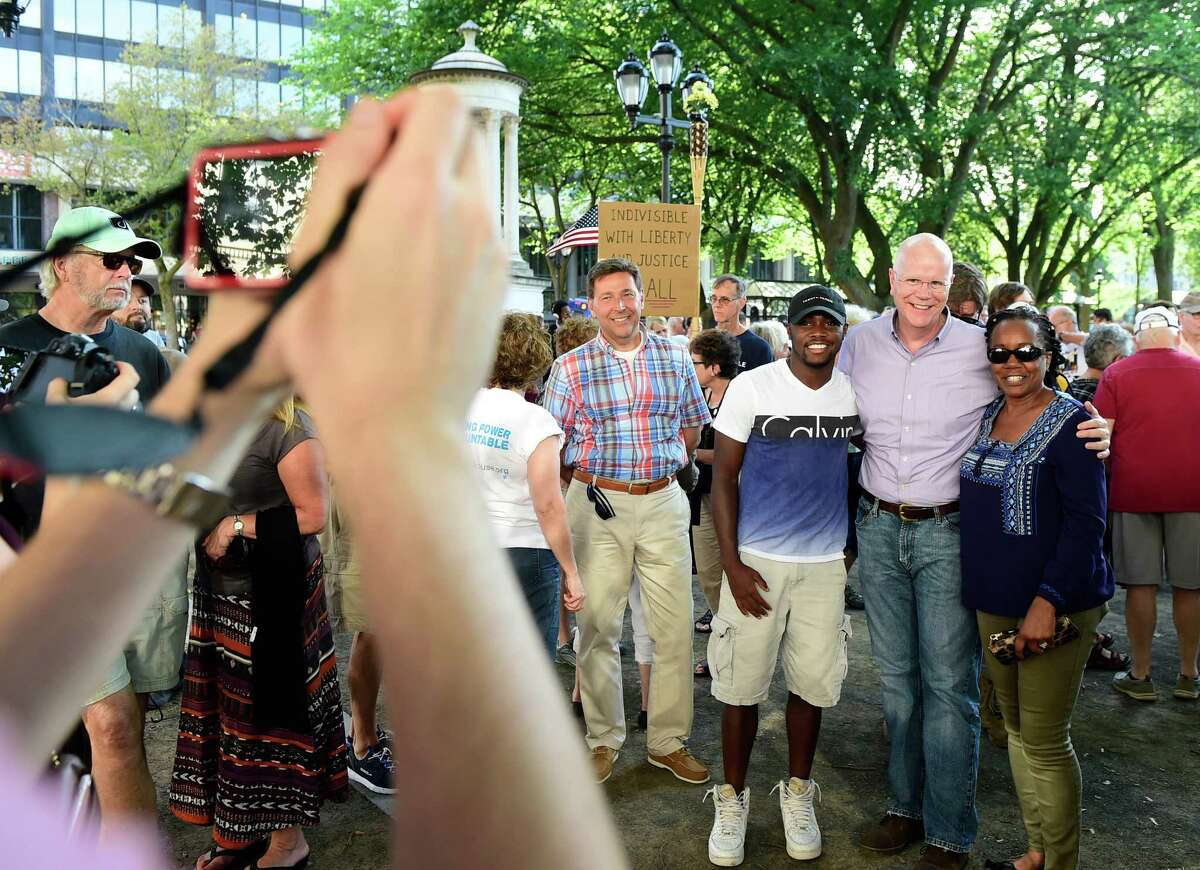 (Peter Hvizdak / Hearst Connecticut Media) New Haven, Connecticut: August 13, 2017. Approximately 600 people attended a rally on the New Haven Green at Church and Chapel Streets in New Haven Sunday evening in solidarity with anti-fascism protestors in Charlottesville, Virginia. Many activists groups were represented at the rally including the ANSWER (Now to Stop War and End Racism) Coalition.