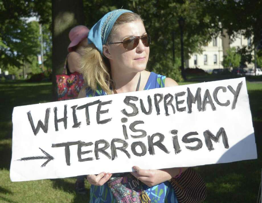 Caroline Kelley holds up a sign during a rally at Park Square in Pittsfield, Mass. one of two held in Berkshire County on Sunday, Aug. 13, 2017, to protest the deadly white supremacist rally in Charlottesville, Va., Saturday. (Gillian Jones/The Berkshire Eagle via AP) Photo: Gillian Jones, MBI / Associated Press / The Berkshire Eagle