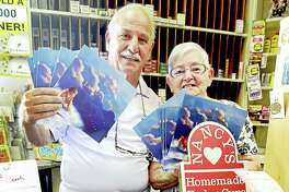 """(Peter Hvizdak - Hearst Connecticut Media) Branford, Connecticut: August 4, 2017.  Bobby Esposito, owner of Branford Book & Card Shoppe and employee Roseann (CQ) Barontini hold copies of the book """"The Littlest Angel"""" by Charles Tazewell at the shop Friday on Main Street in Branford.  Following the drowning of 10-year-old Ben Callahan, an anonymous Branford woman is donating 330 free copies of the book to be distributed around town as a way of helping children cope with Callahan's death by understanding death and faith. Copies of the book have also been donated to Branford libraries, churches and the YMCA."""
