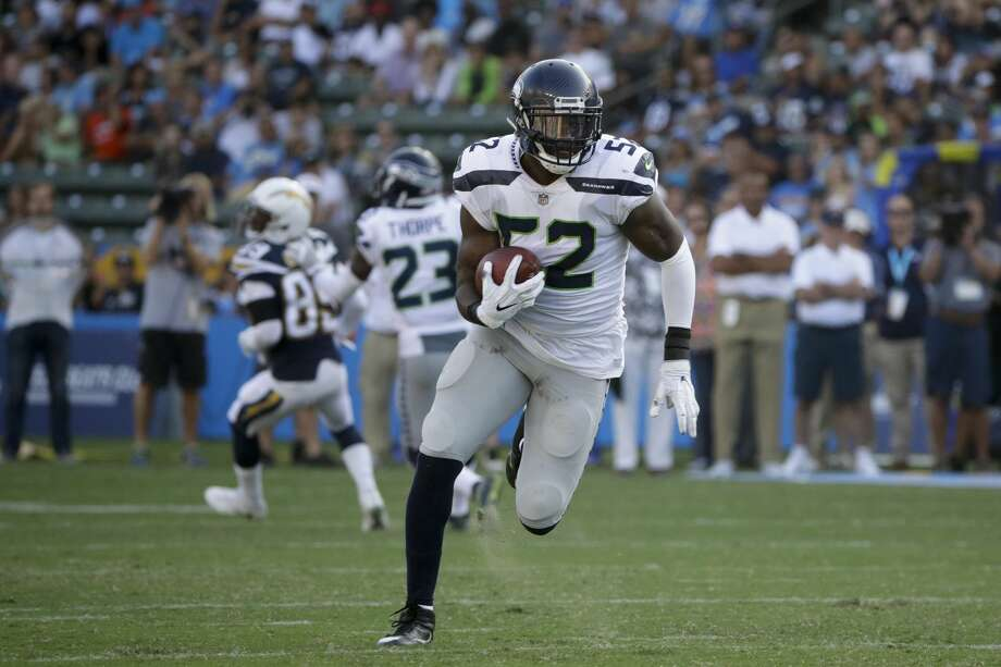 Seattle Seahawks linebacker Terence Garvin (52) runs back an interception for a touchdown during the first half of an NFL preseason football game against the Los Angeles Chargers Sunday, Aug. 13, 2017, in Carson, Calif. (AP Photo/Jae C. Hong) Photo: Jae C. Hong/AP