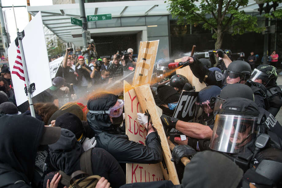 """Police and Antifa members in the """"Solidarity Against Hate"""" march clash at 2nd Ave. and Pine St. on Sunday, Aug. 13, 2017. Photo: GRANT HINDSLEY, SEATTLEPI.COM / SEATTLEPI.COM"""