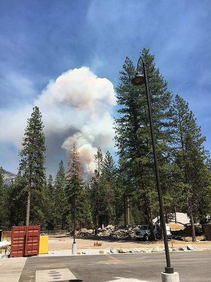 Park rangers closed the Chilnualna Falls Trail, where a large plume of smoke could be seen rising from the mountainous region, fire officials said. Photo: National Park Service