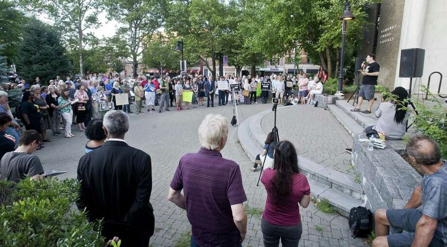 Justin Molito, of Sherman, addresses the gathering at the Solidarity Vigil for Charlottesville and Against Hate, held at the Danbury Library. Sunday, Aug. 13, 2017 Photo: Scott Mullin / For Hearst Connecticut Media / The News-Times Freelance