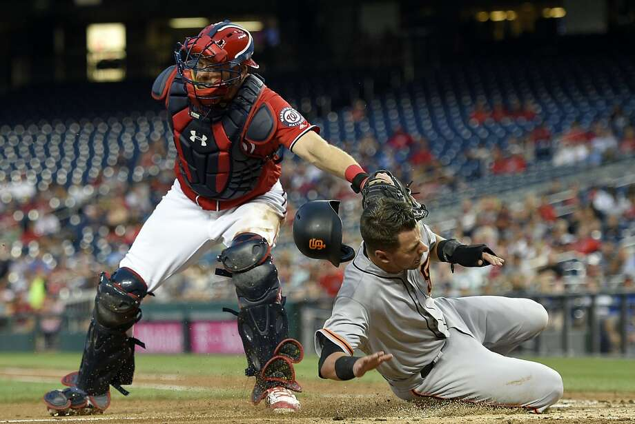 San Francisco Giants' Joe Panik, right, is tagged out by Washington Nationals catcher Matt Wieters, left, during the fourth inning of the second baseball game of a split doubleheader, Sunday, Aug. 13, 2017, in Washington. (AP Photo/Nick Wass) Photo: Nick Wass, Associated Press