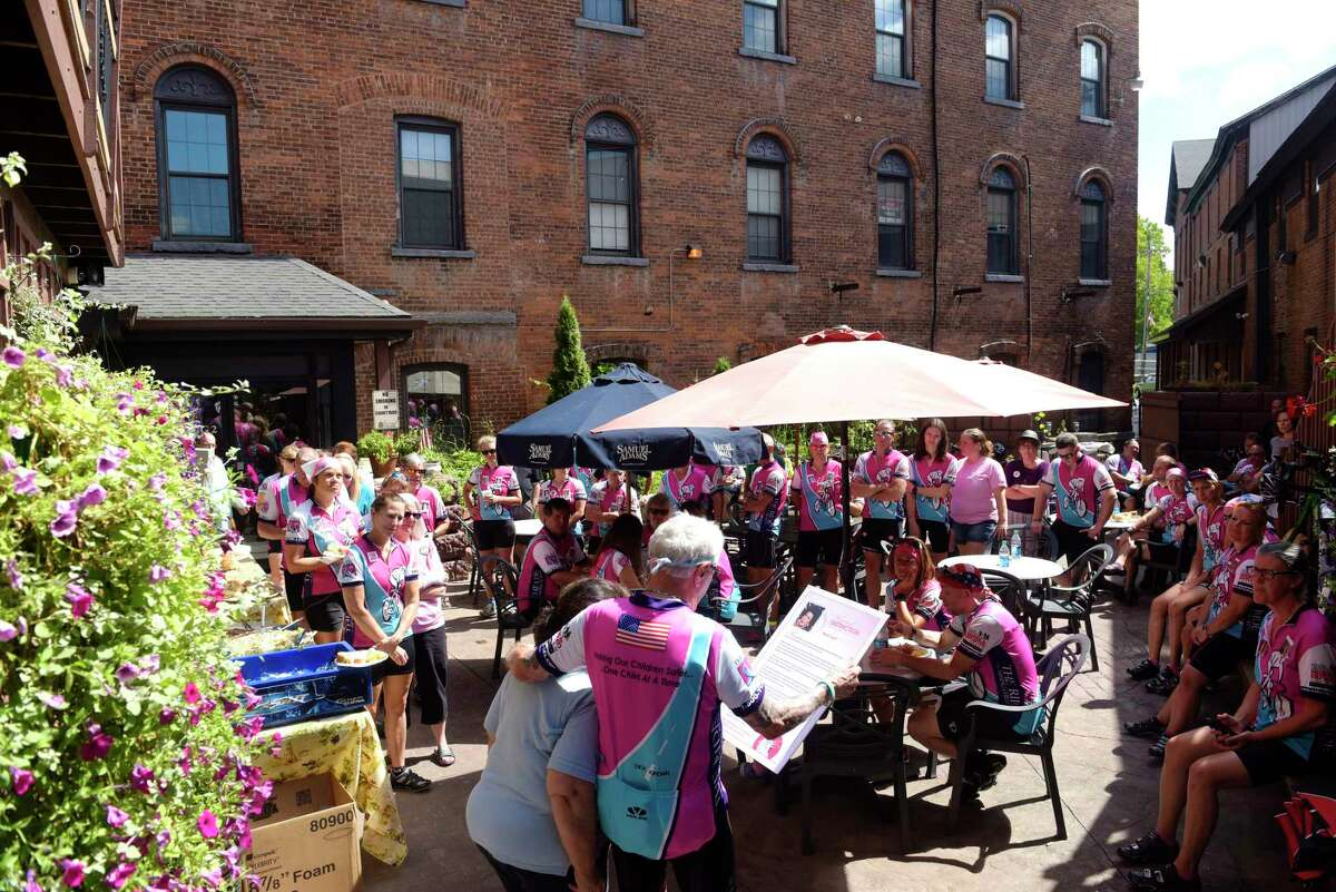 Members of the Greater Capital District Ride for Missing Children and members of the Central New York chapter gather around as Mary Lyall, foreground left, the mother of missing Suzanne Lyall, addresses them at the Center For Hope on Sunday, Aug. 13, 2017, in Ballston Spa, N.Y. The riders took part in a 40-mile bicycle ride on Sunday to show support for the families of local missing children including Suzanne Lyall, Tammie Anne McCormick and Craig Frear. The 10th Annual Greater Capital District Ride for Missing Children will be held on Friday, September 29, 2017, beginning at the University at Albany. The first missing children's ride began in the Utica area with seven riders in 1995. (Paul Buckowski / Times Union)