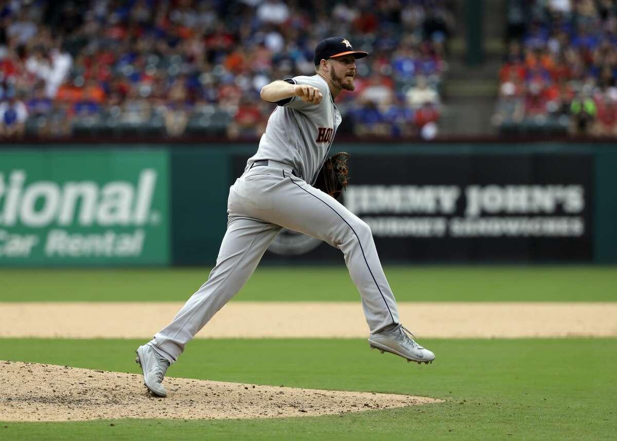 Houston Astros' Chris Devenski follows through on his delivery to the Texas Rangers in the eighth inning of a baseball game, Sunday, Aug. 13, 2017, in Arlington, Texas. (AP Photo/Tony Gutierrez)