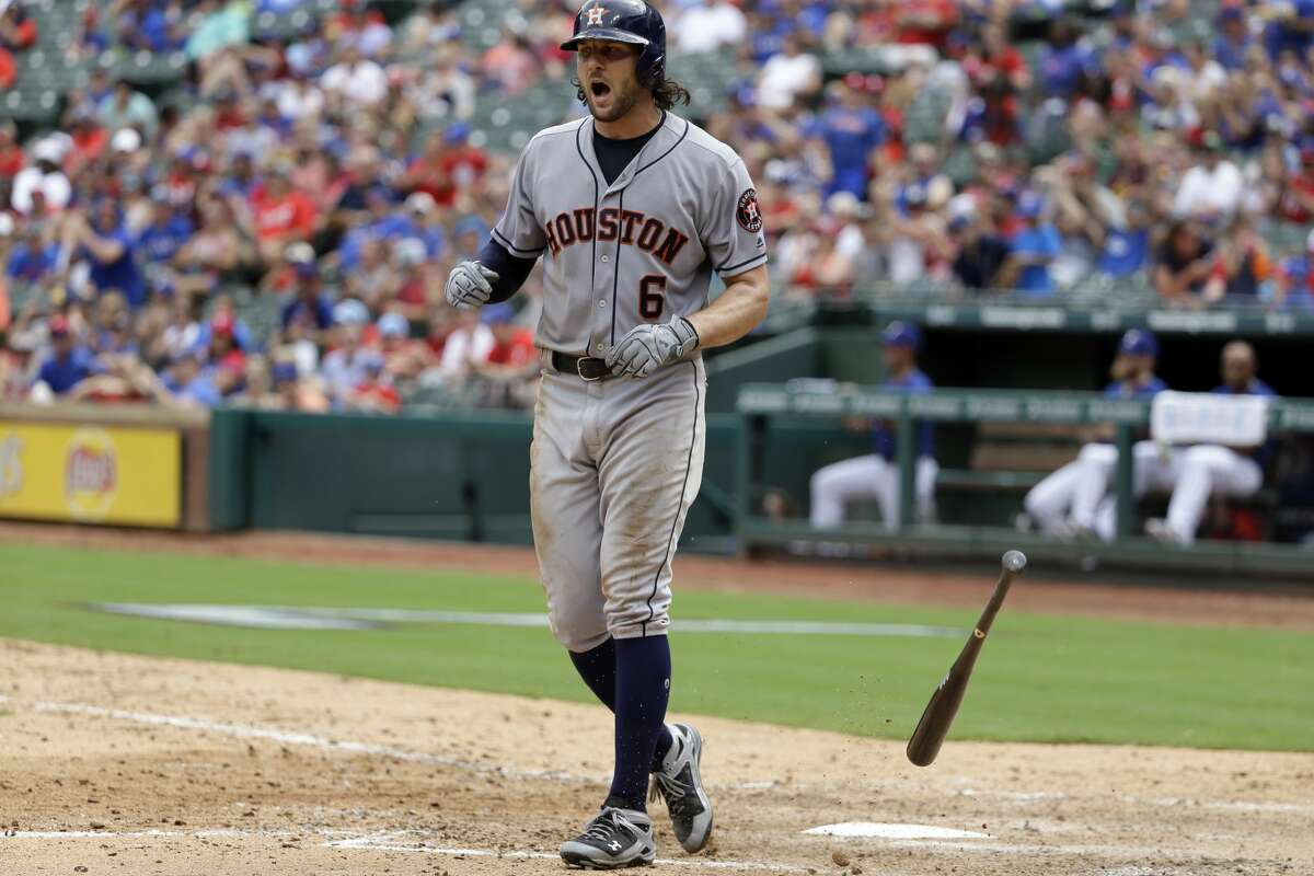 Houston Astros' Jake Marisnick tosses his bat to the ground after striking out against the Texas Rangers with runners on in the seventh inning of a baseball game, Sunday, Aug. 13, 2017, in Arlington, Texas. (AP Photo/Tony Gutierrez)