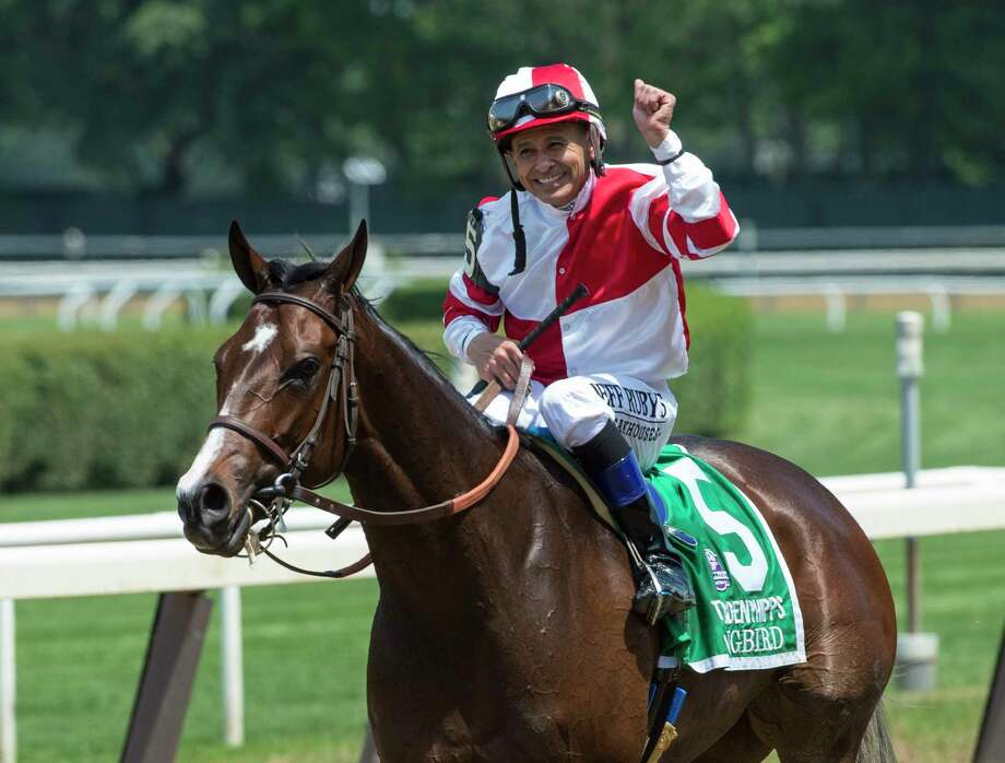 Mike Smith is jubilant aboard Songbird after winning the 49th running of The Ogden Phipps over Paid Up Subscriber with Javier Castellano up at Belmont Park June 10, 2017 in Elmont, N.Y.  (Skip Dickstein/Times Union) Photo: SKIP DICKSTEIN