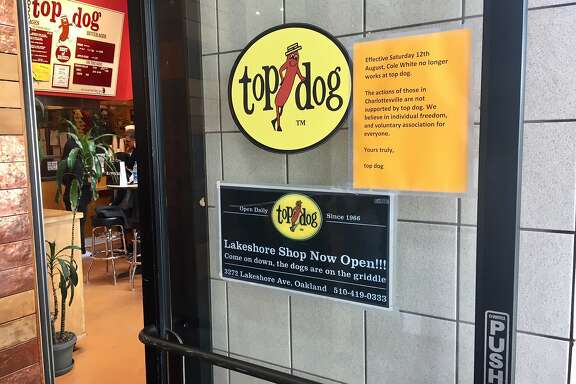 East Bay hot dog chain Top Dog posted notice Sunday that it had fired an employee after he was reported to have participated in a white nationalist rally in Charlottesville, Va.