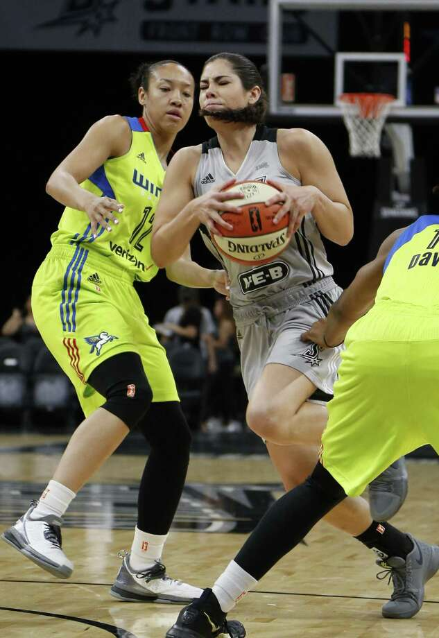 Dallas Wings guard Saniya Chong, left, guards Kelsey Plum of the San Antonio Stars during a game on May 25. Photo: San Antonio Express / File Photo / Freelance