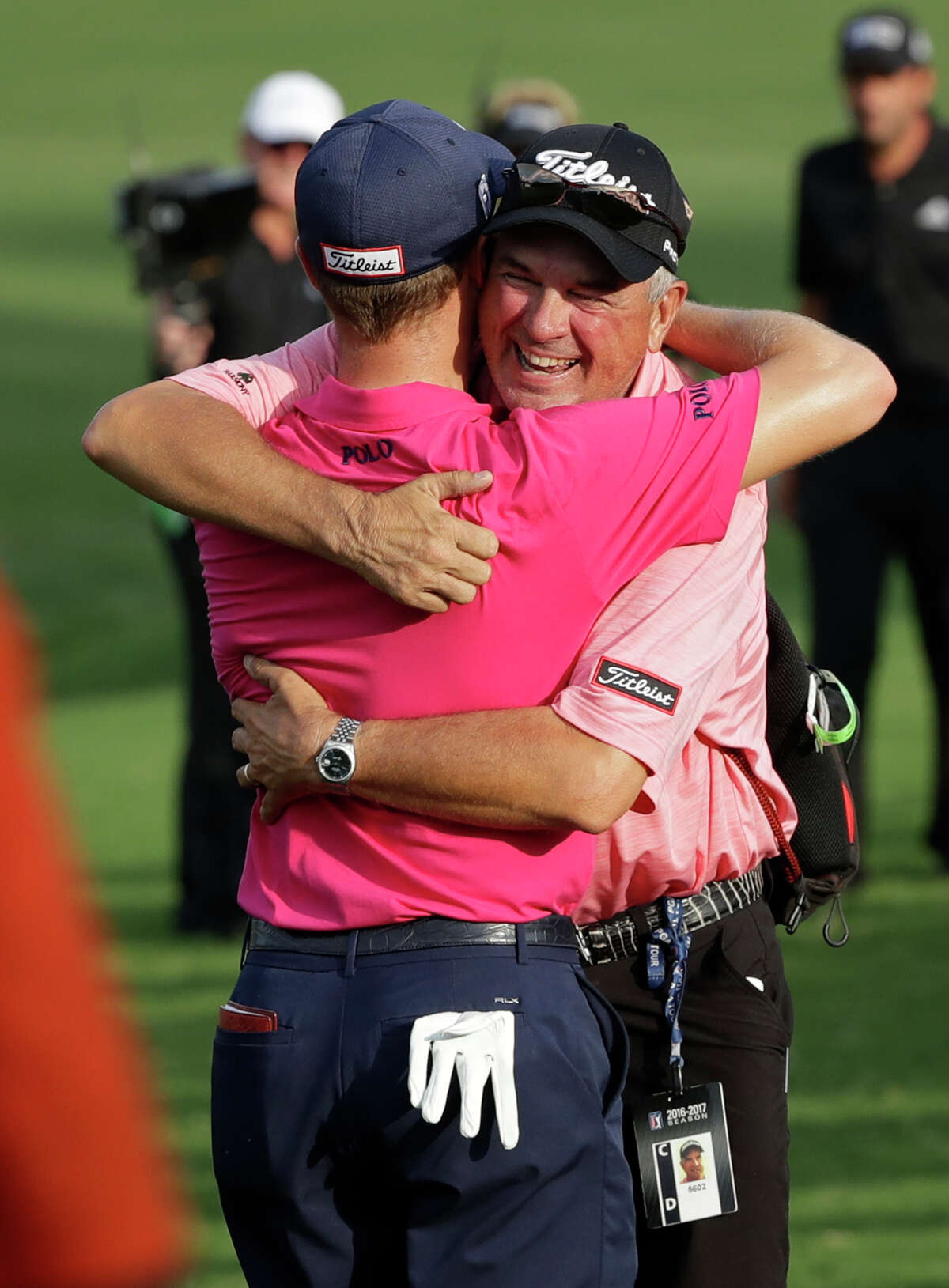 Justin Thomas, left, hugs his dad Mike after the final round of the PGA Championship golf tournament at the Quail Hollow Club Sunday, Aug. 13, 2017, in Charlotte, N.C. (AP Photo/John Bazemore) ORG XMIT: PGA191