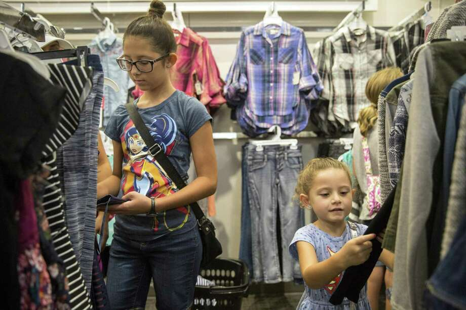 Megan Alverson, 13, and Ariana Weber, 5, shop with their mom Ruthie Patron, not pictured, at Kohl's in San Antonio, Texas during tax free weekend on August 13, 2017. Ray Whitehouse / for the San Antonio Express-News Photo: Ray Whitehouse, Photographer / For The San Antonio Express-New