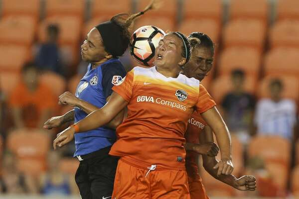 Houston Dash players Amber Brooks (12) and Bruna Benites (4) and FC Kansas City forward Sydney Leroux (14) all go up for a header during the first half of the game at BBVA Compass Stadium Sunday, Aug. 13, 2017, in Houston. ( Yi-Chin Lee / Houston Chronicle )