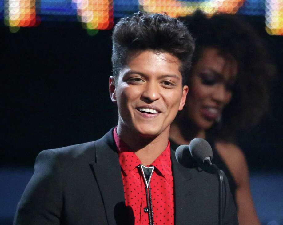 """FILE - This Jan. 26, 2014 file photo shows Bruno Mars accepting the award for best pop vocal album for """"Unorthodox Jukebox"""" at the 56th annual Grammy Awards in Los Angeles. Mars will answer questions about his Super Bowl halftime performance at the Rose Theater in the Time Warner Center in New York City on Thursday. Renee Fleming, who will sing the national anthem, will give a press conference before Mars. (Photo by Matt Sayles/Invision/AP, File) ORG XMIT: NYET400 Photo: Matt Sayles / Invision"""